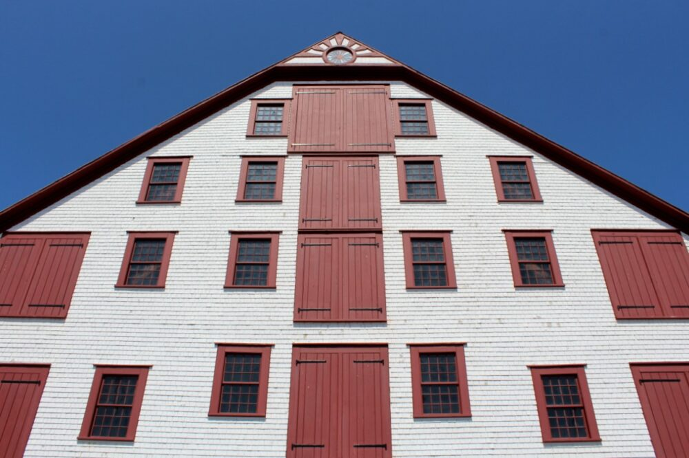 Red and white four storey fish packing building