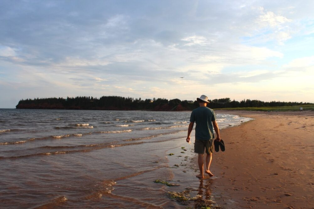 JR walking closely next to the ocean on Little Harbour Beach, PEI