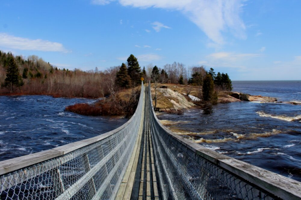 Bridge leading over a raging river in Quebec