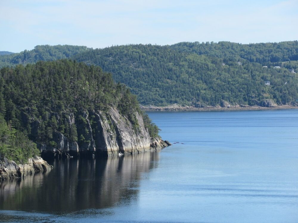 Calm ocean with fjord cliffs in Saguenay