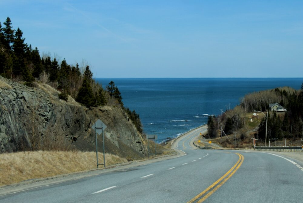 Highway turning and following coast closely on Gaspe Peninsula