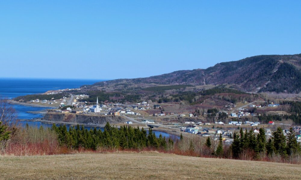 Coastal village with church and small houses on the Gaspe Peninsula