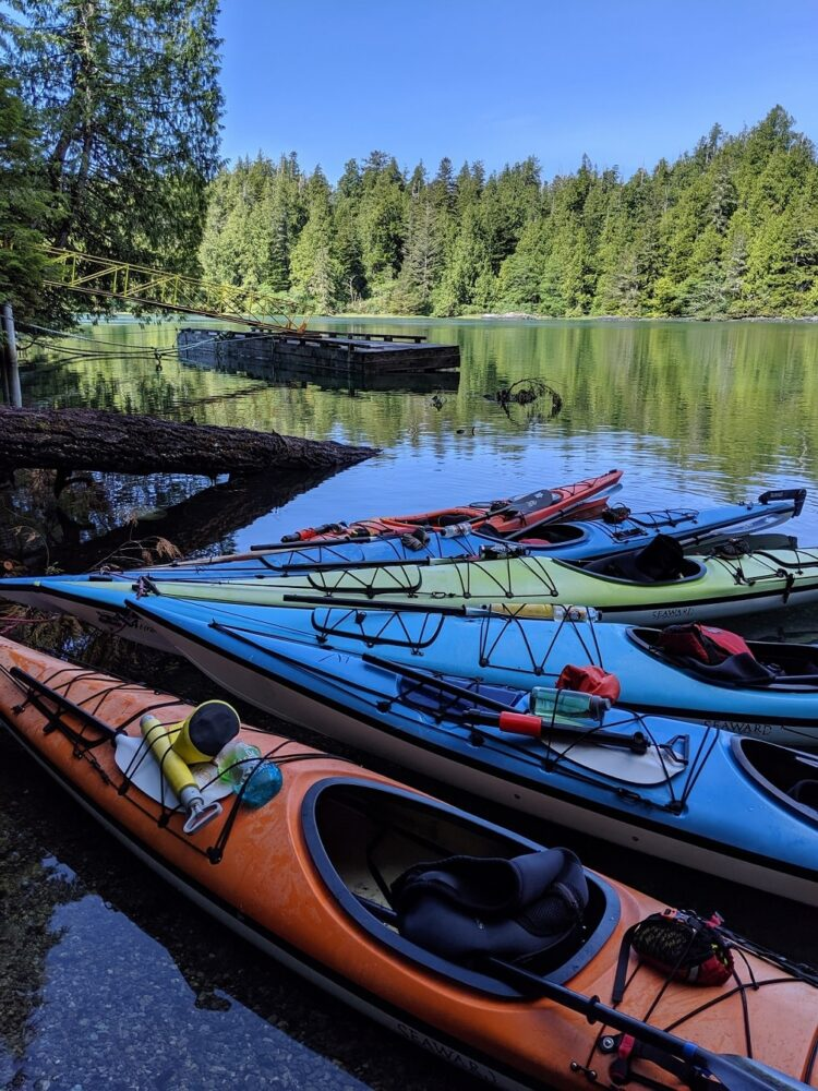 Colourful kayaks tied together in Clayoquot Sound, Tofino