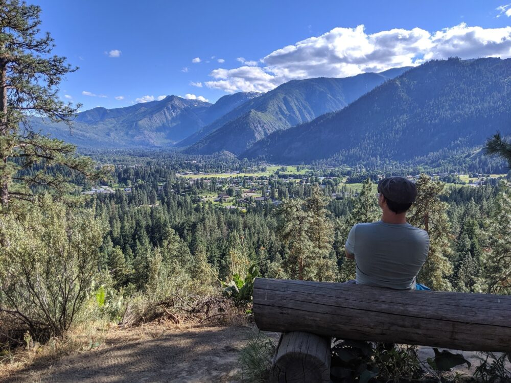 JR sat on a bench looking at the views of Leavenworth and surrounding mountains