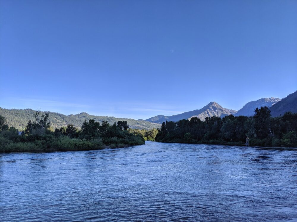 Rippling river with mountain backdrop views from Blackbird Island