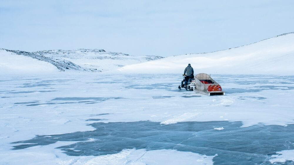 Snowmobile crossing icefields near Iqaluit, Nunavut