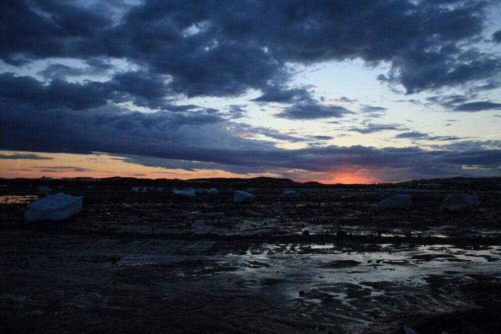 Sunset behind icebergs near Iqaluit, Nunavut