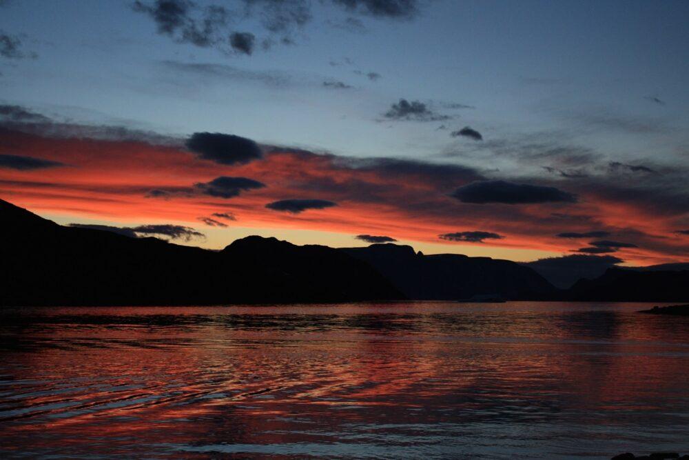 Red sunset over water near Iqaluit, Nunavut
