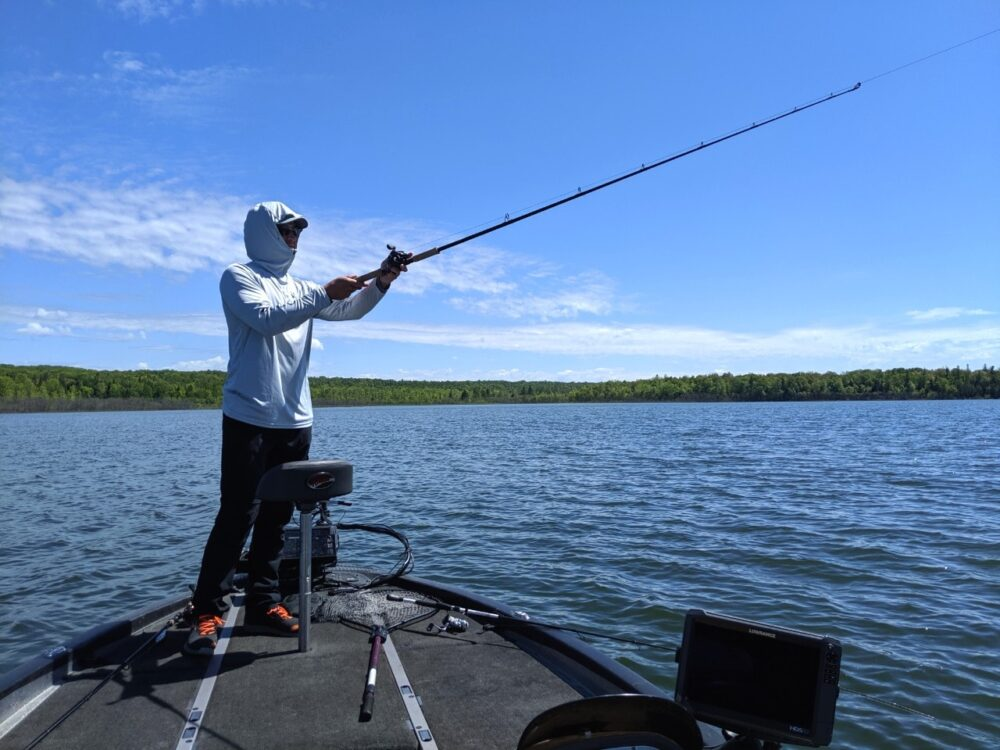 Adam from Angling Algoma fishing off boat on Lake Huron