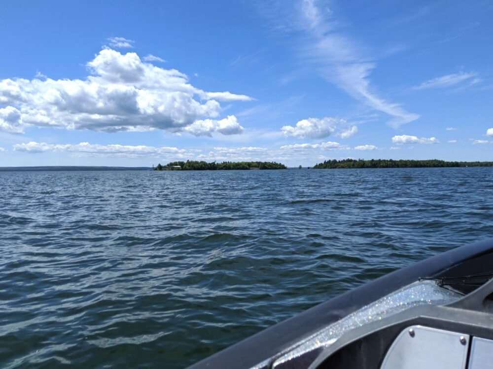 Boating on Lake Huron, water and island view with side of boat