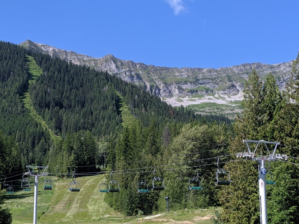 Chairlift backdropped with mountains at Fernie Alpine Resort, BC
