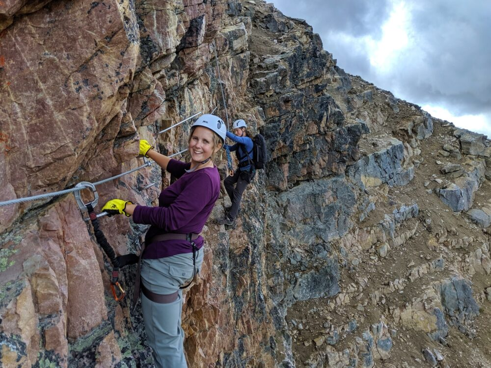 Gemma and guide Lenka traversing on the Via Ferrata at Kicking Horse