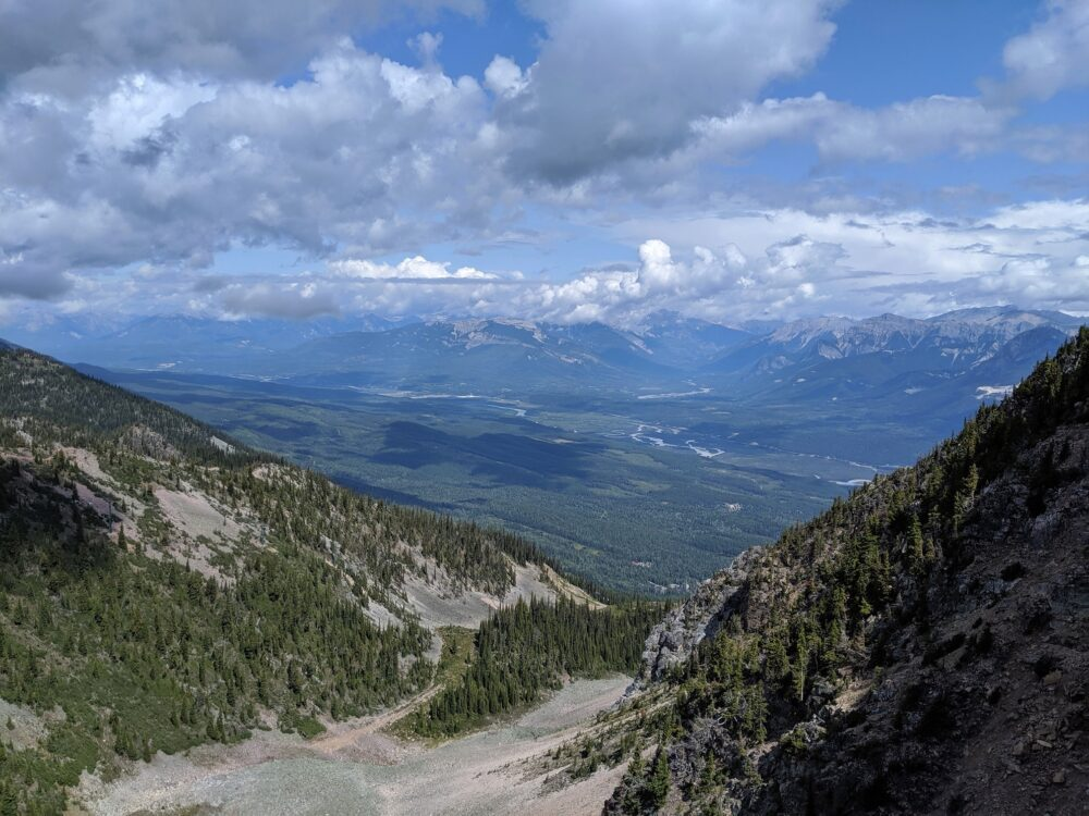 Views from Kicking Horse's Via Ferrata course of mountain peaks and a river valley