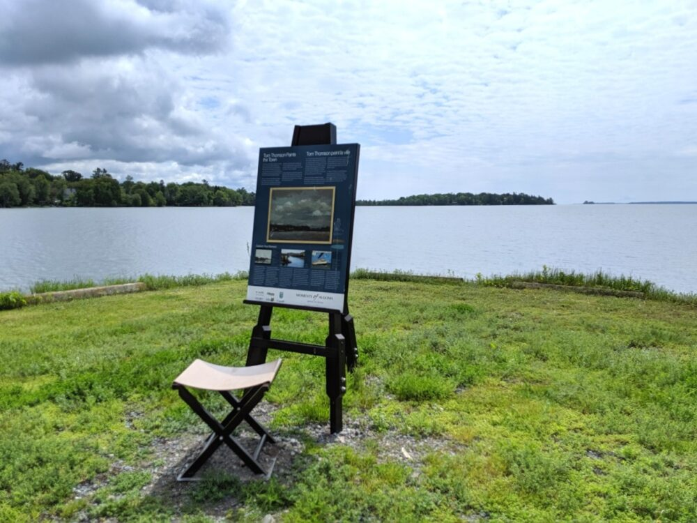 An artist's easel and stool next to the Bruce Mines shoreline, marking the inspiration of the area for the Group of Seven