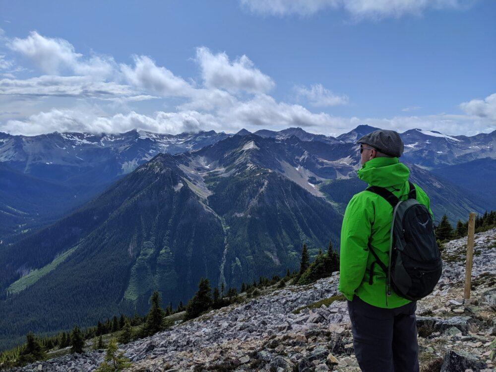 JR looking out to mountain vistas at Kicking Horse Mountain Resort
