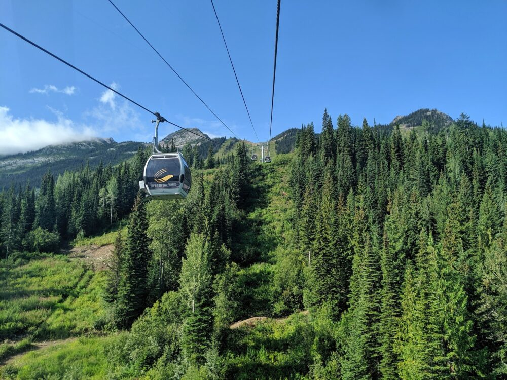 View from gondola cabin towards mountain peak