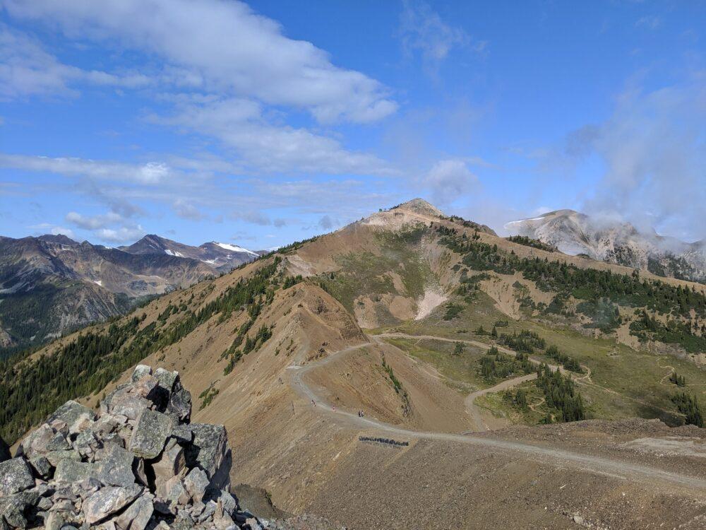 A hiking trail leads towards a mountain ridge