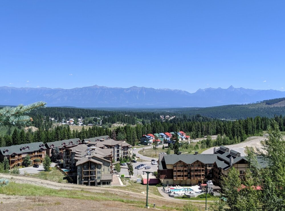 Condo and chalet buildings at Kimberley Alpine Resort in British Columbia, backdropped by mountains