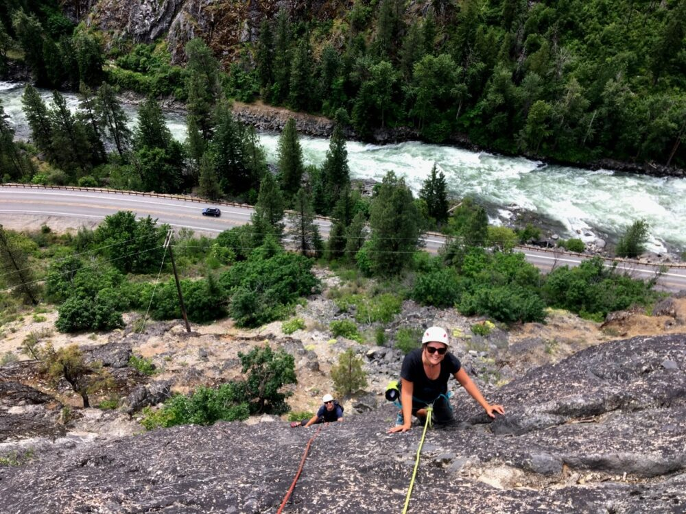 Gemma and JR scaling a granite cliff - climbing is one of the best things to do in Leavenworth, Washington