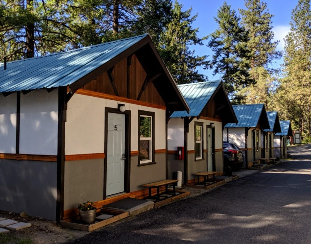 Side view of five LOGE cabins, next to the river in Leavenworth