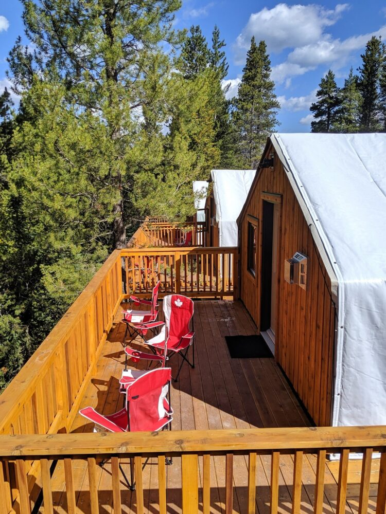 Three tent decks with Canada themed chairs at Mount Engadine Lodge