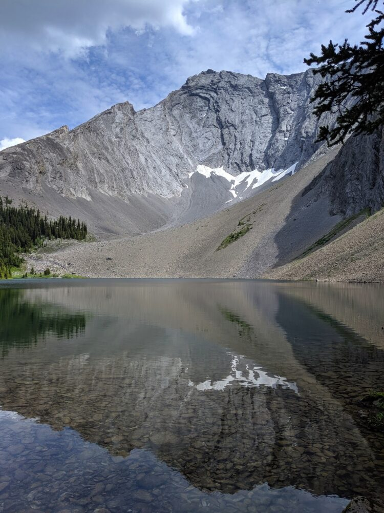 Mirror lake reflections on Rummel Lake in the Kananaskis Valley