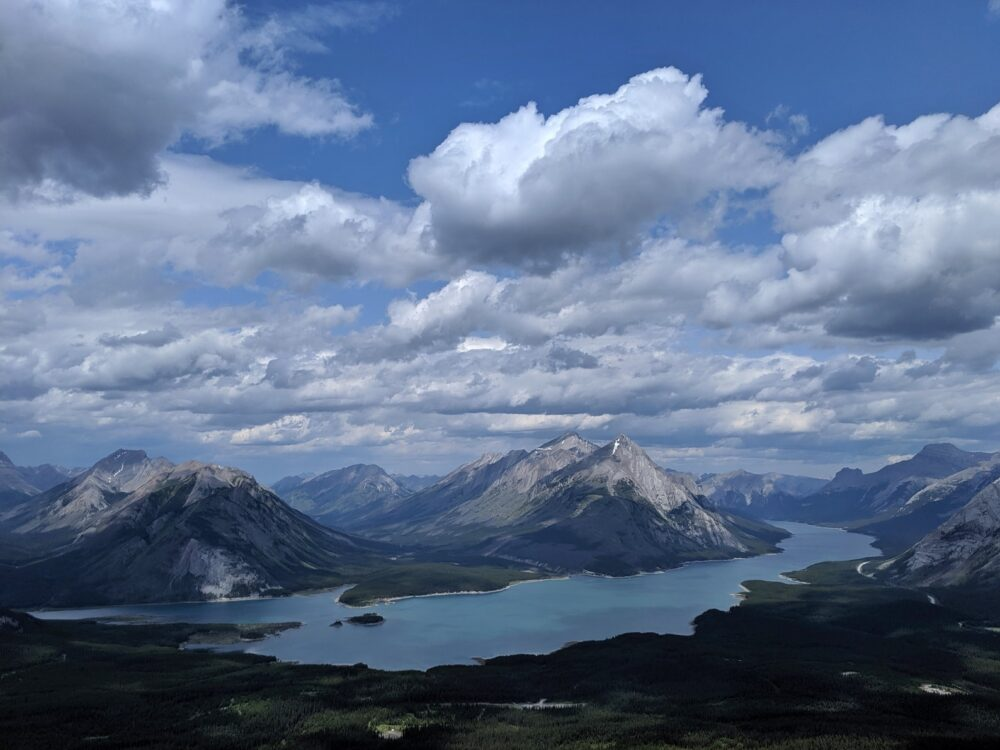 Elevated view of mountains intersected by lake reservoir in the Kananaskis Valley