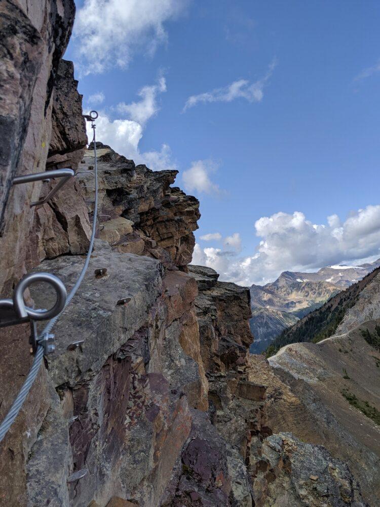 Steel Via Ferrata hardware on rock edge, Kicking Horse Mountain Resort Via Ferrata