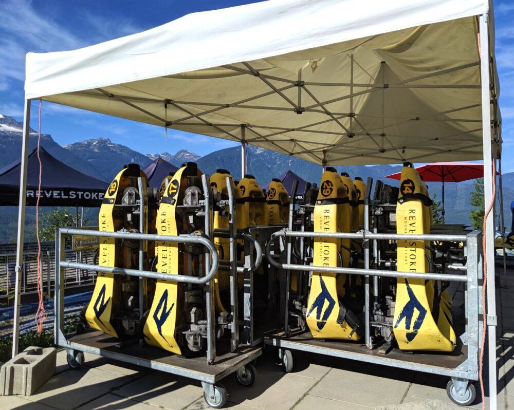Yellow Revelstoke Mountain Coaster carts standing vertically in storage