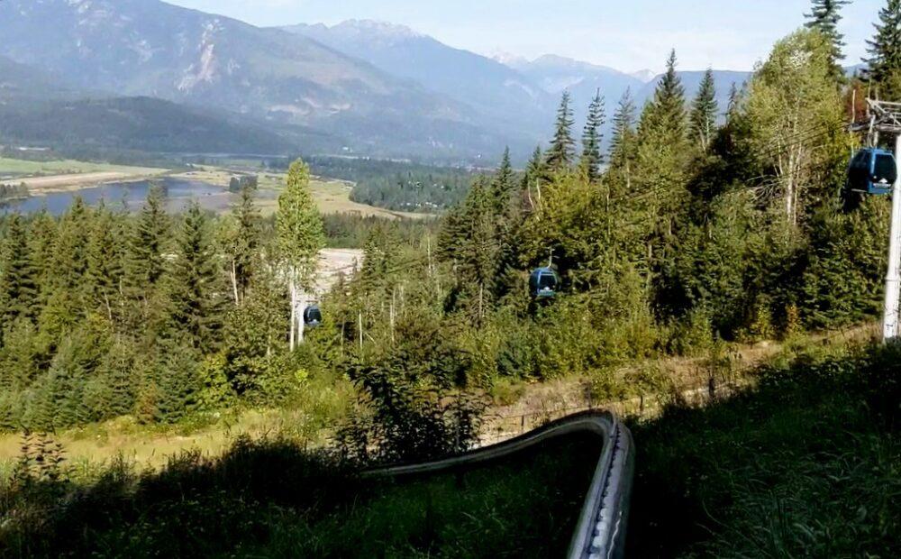 View of Revelstoke Mountain Coaster track heading towards ski resort gondola