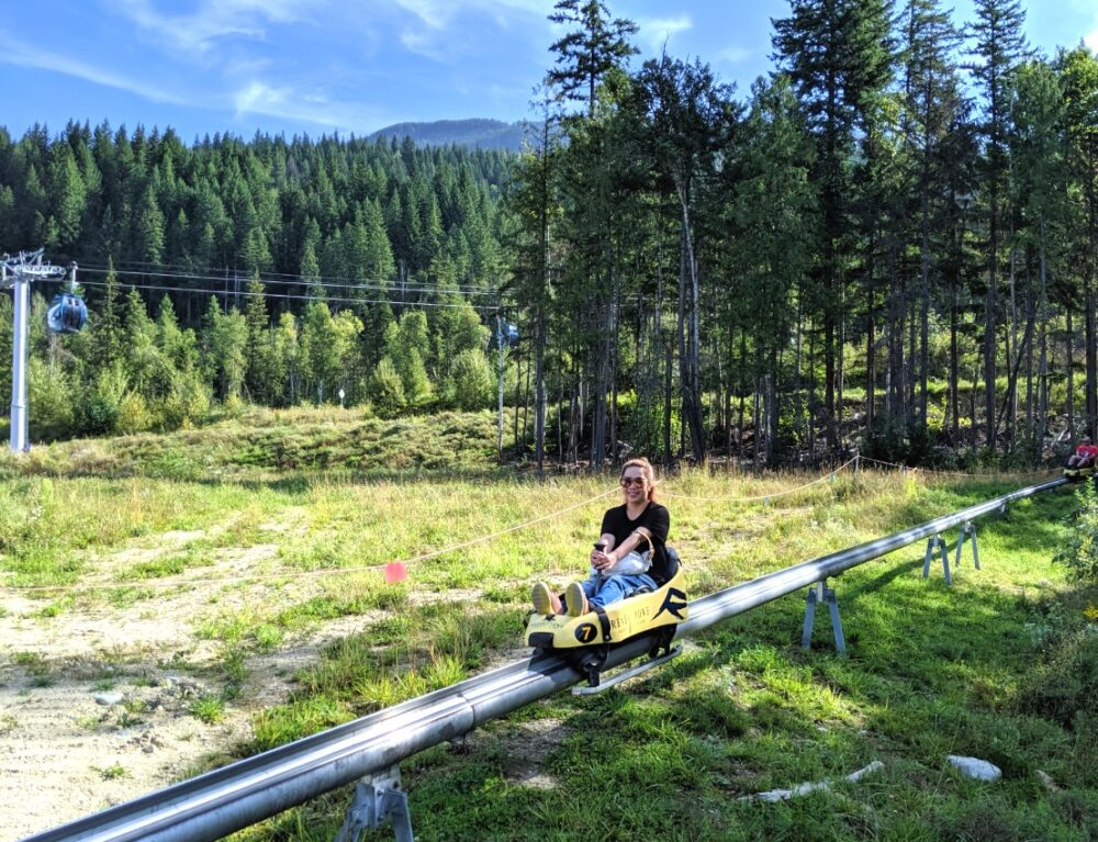 A rider on the Revelstoke Mountain Coaster going downhill