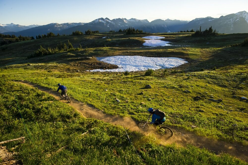 Mountain biking is one of the most exciting must do Revelstoke activities - mountain bikers in alpine