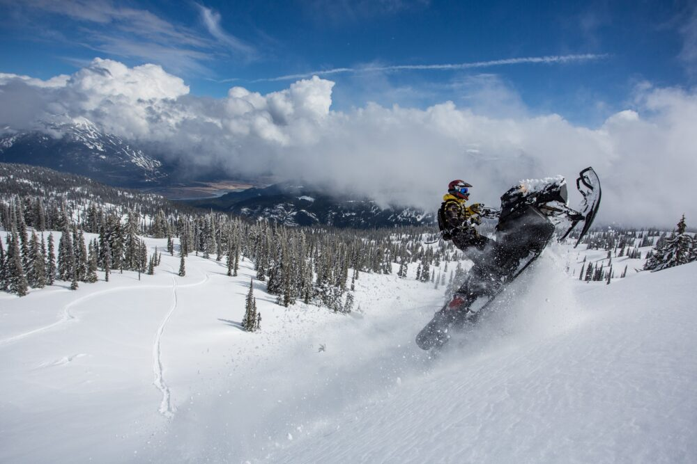 Snowmobiling in the backcountry of Revelstoke