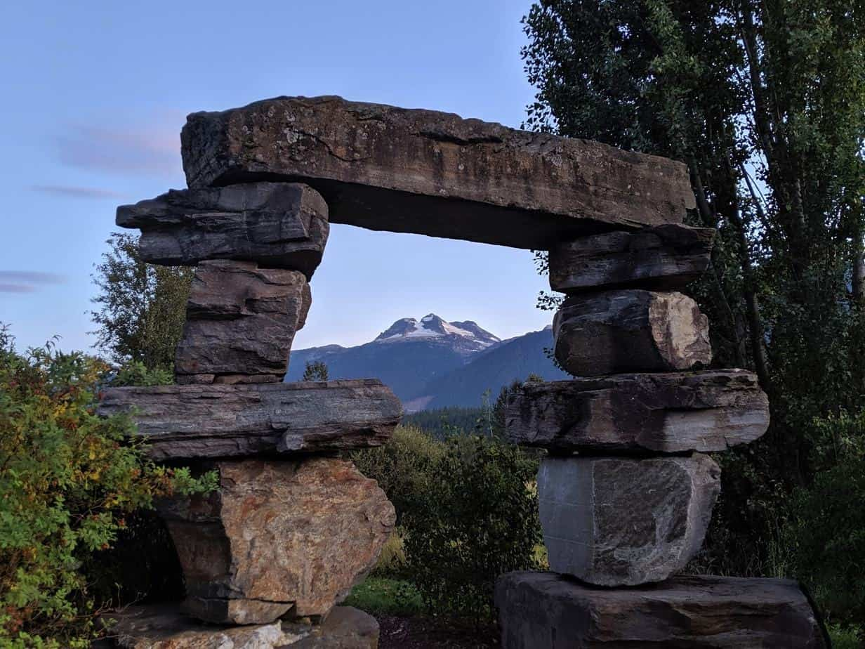 Sunset view of Mount Begbie, Revelstoke, surrounded by stone sculpture