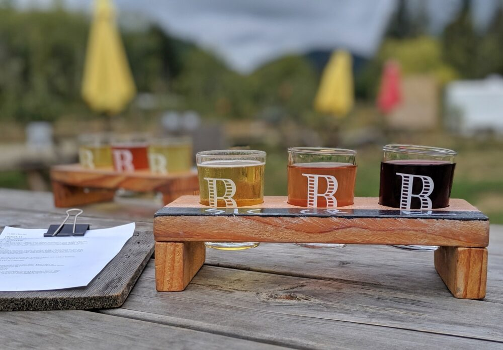 Six tasting sizes of cider on table at Bricker Cider Company garden