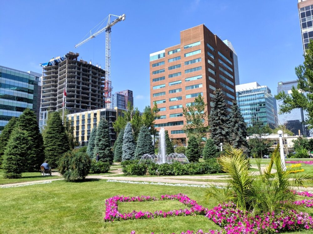 City park with high rise buildings and crane behind
