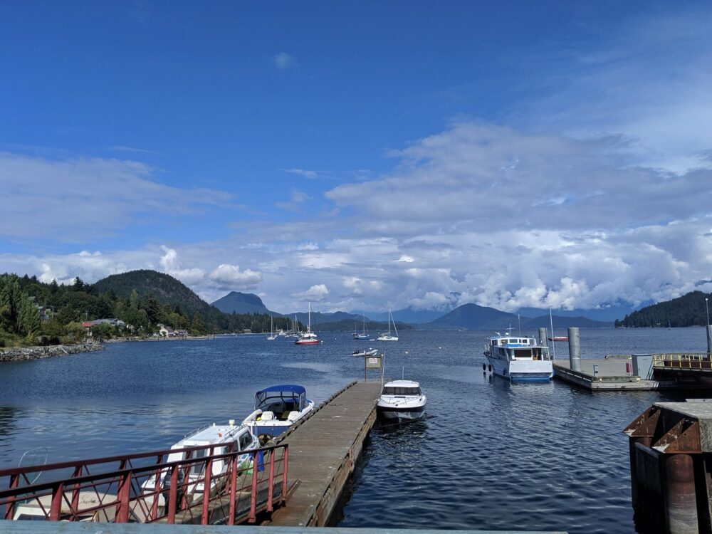 Calm harbour with mountains in background