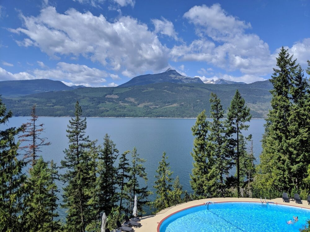 Halcyon Hot Springs pool backdropped by Upper Arrow Lake and mountains
