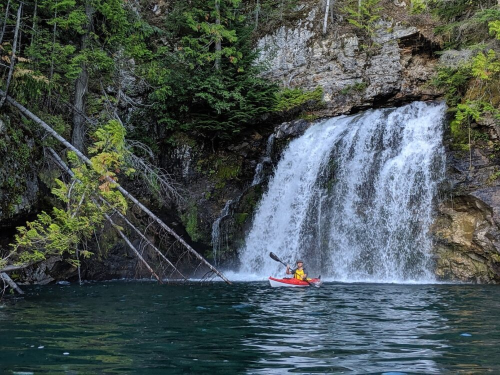 JR kayaking in front of a waterfall, Lake Revelstoke