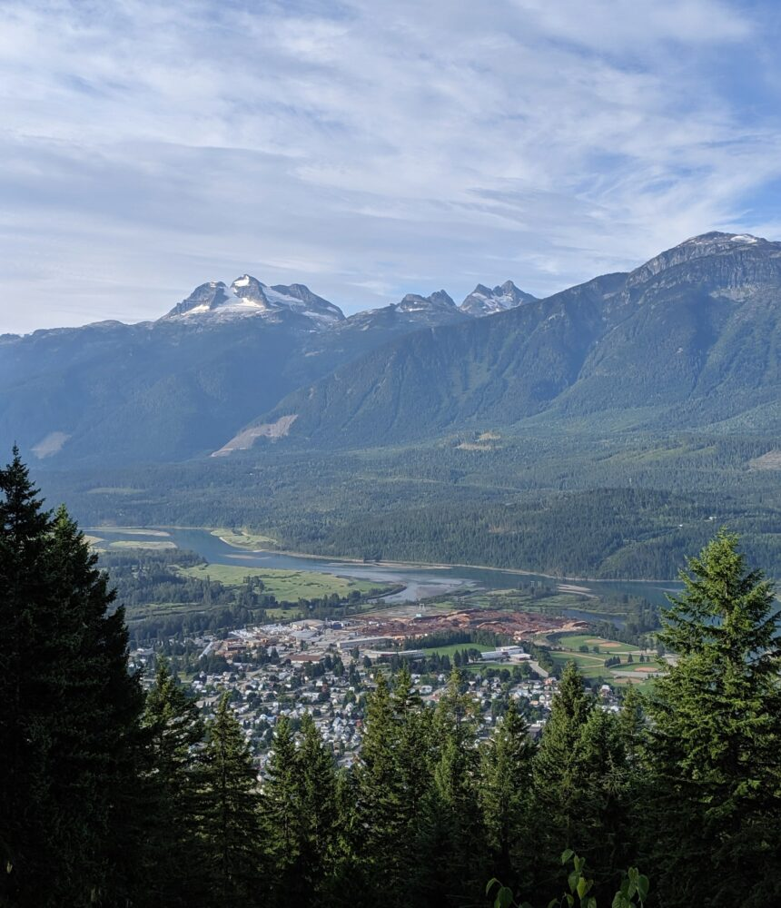 Town of Revelstoke from above with Mount Begbie and Monashee Mountains in background