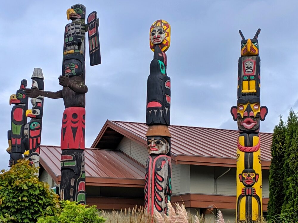 Colorful carved totem poles on the Sunshine Coast