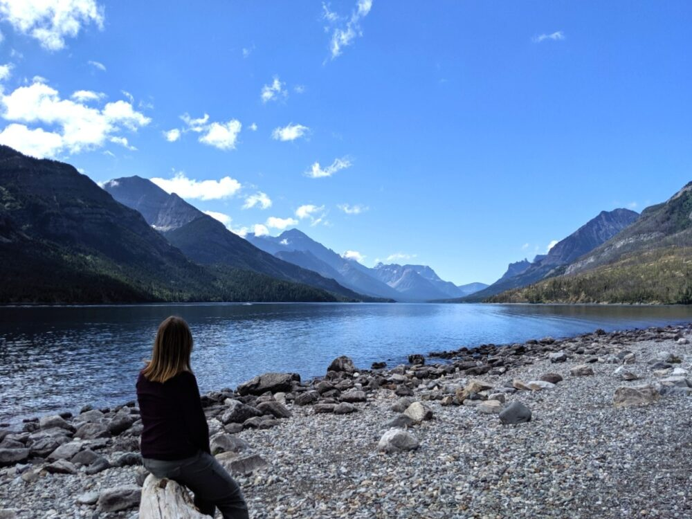 Gemma sat in front of Waterton Lake, Waterton Lakes National Park