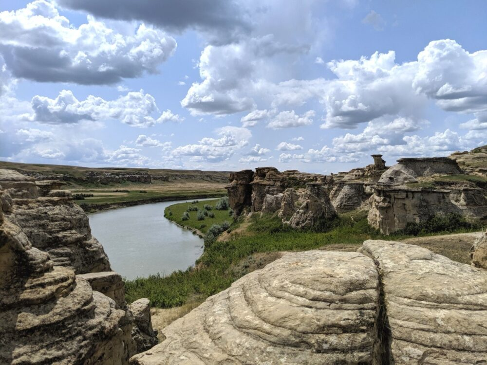 Milk River winding next to hoodoos in Writing-on-Stone Provincial Park