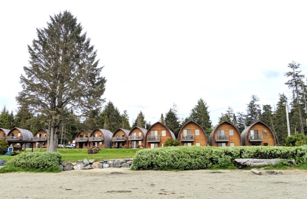 Two floor cabins sit just behind beach at Ocean Village Resort, Tofino