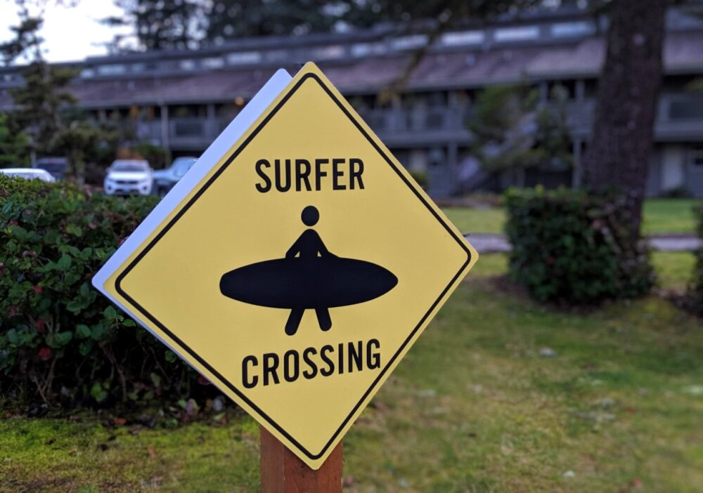 Surfer crossing sign in Tofino