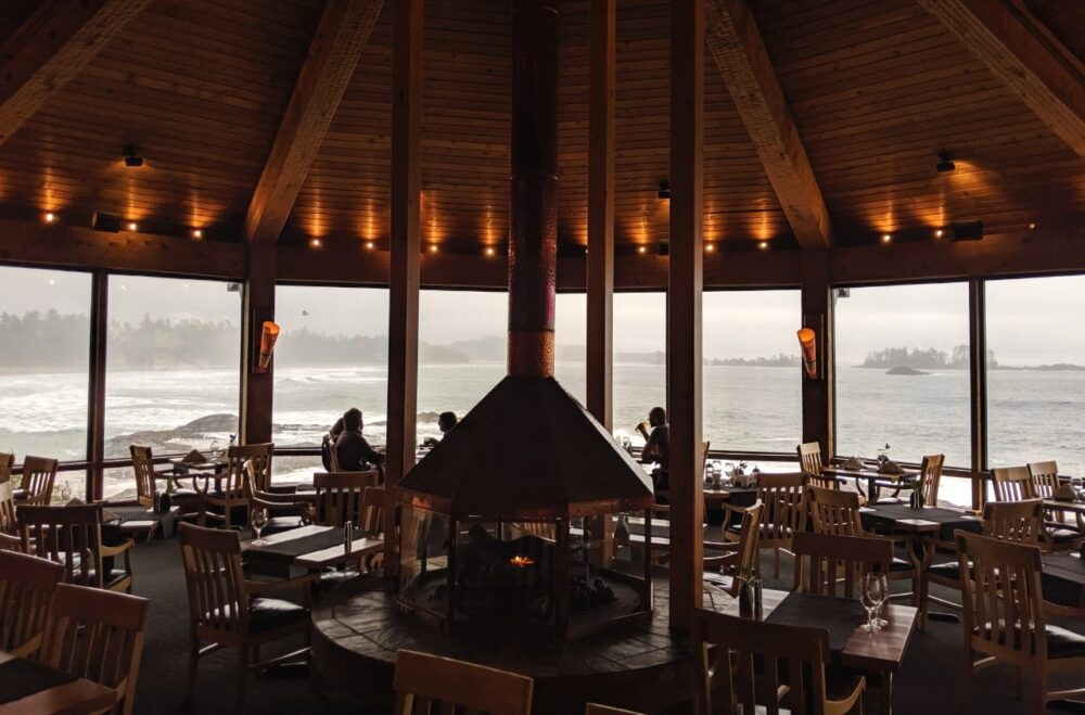 Circular restaurant with large windows and views towards the ocean
