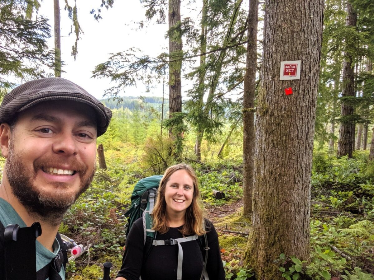 Gemma and JR selfie with tree and 134km kilometre marker in background