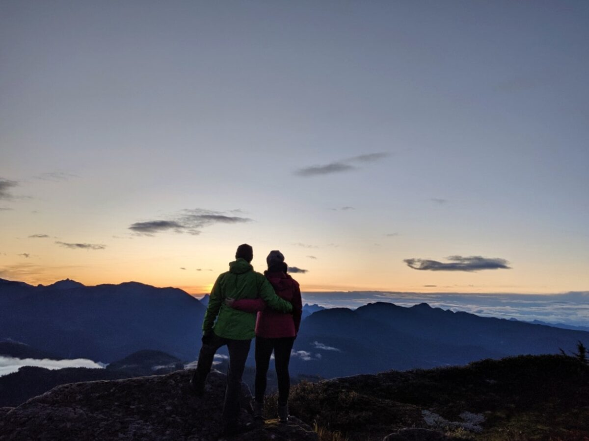 Gemma and JR standing together looking at sunrise from Tin Hat Mountain