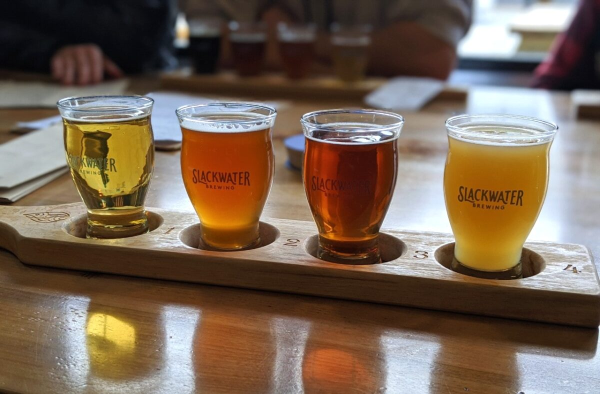 Four beers on wooden tasting flight at Slackwater Brewing