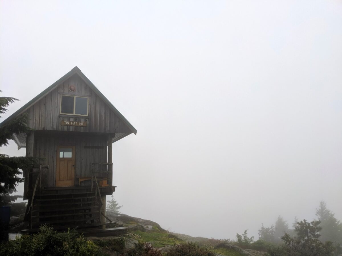 Tin Hat Mountain hut in cloud, with zero views behind